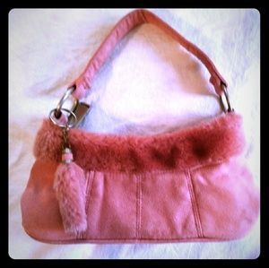 pink suede purse with faux rabbit trim and charm